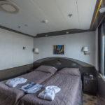 Schlafbereich einer Suite der MS Hamburg